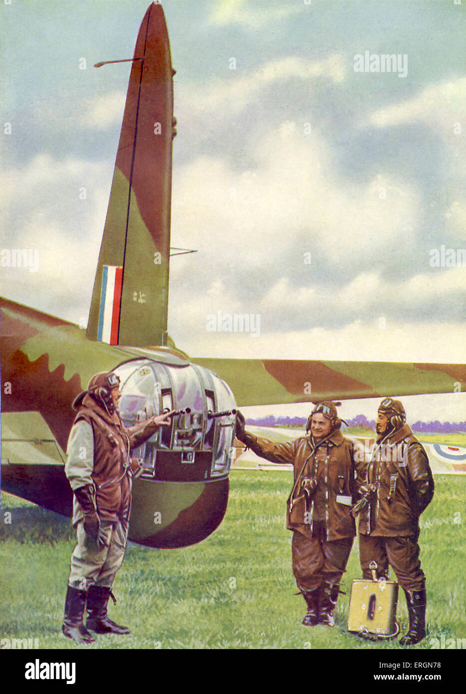 WW2 - Pilots inspect the machine gun turret at the rear 'f a  British Wellington bomber. Caption reads: The - Stock Image