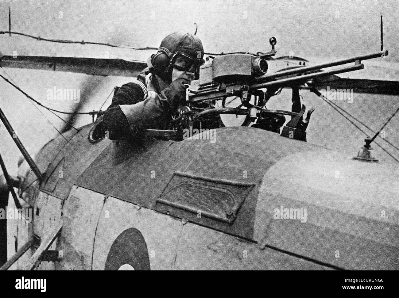 WW2 -RAF Gunnery Training. Man in open cockpit of a biplane training for the Fleet Air Arm. - Stock Image