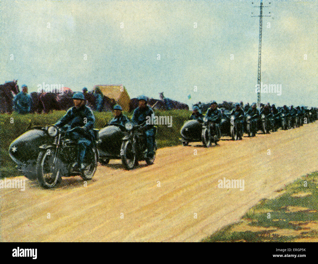 French military motor cycle unit for speedy transsport of troops and news relays . c. 1934   (Source: Cigarette - Stock Image