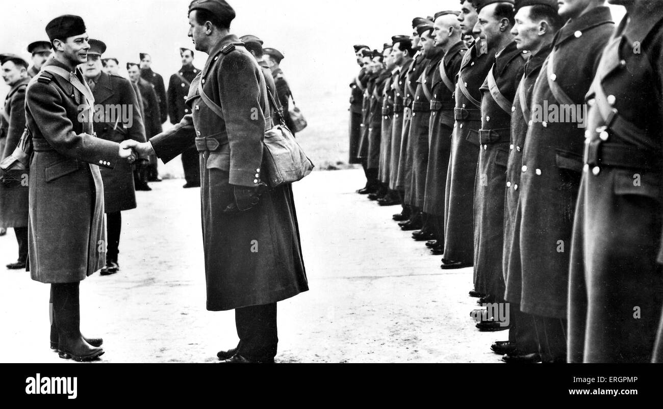 WW2 - King George VI meets members of the RAF.  Caption reads: ' Officers and men being presented to the King - Stock Image