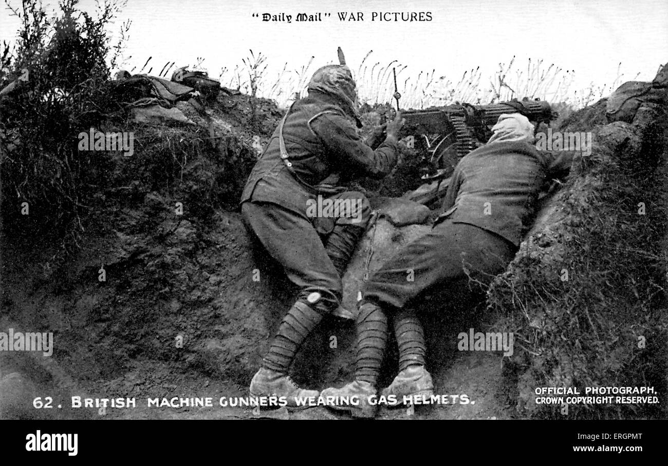 WW1 -  British machine gunners wearing gas helmets. Caption reads: 'War is no longer shell for shell and shot - Stock Image