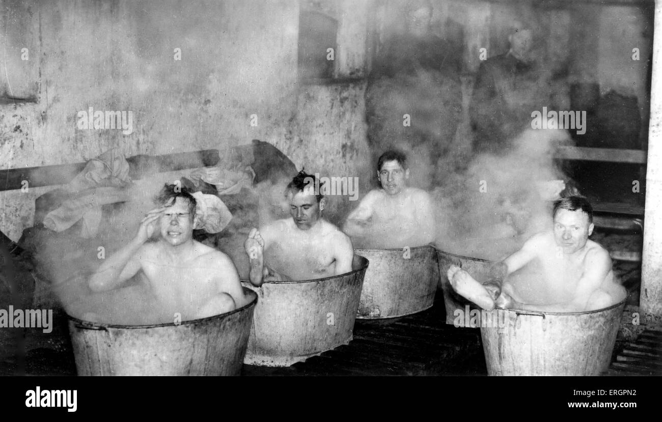 WWII -  British soldiers take a bath. Caption reads: 'Dorsets out of battle dress: At the end of a day's - Stock Image