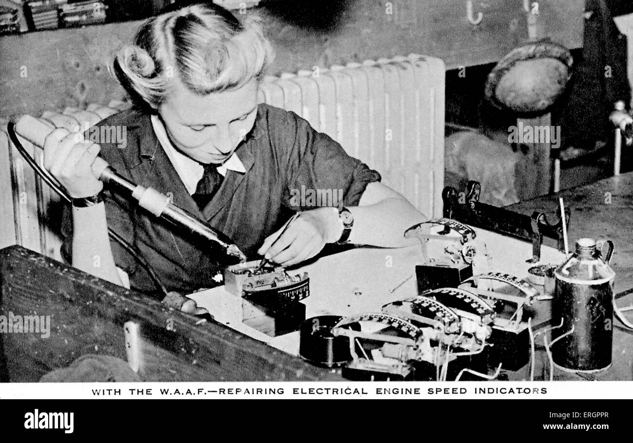 Women 's Auxiliary Air Force (WAAF) - A woman, dressed in overalls, repairs an electrical engine speed indicator. - Stock Image