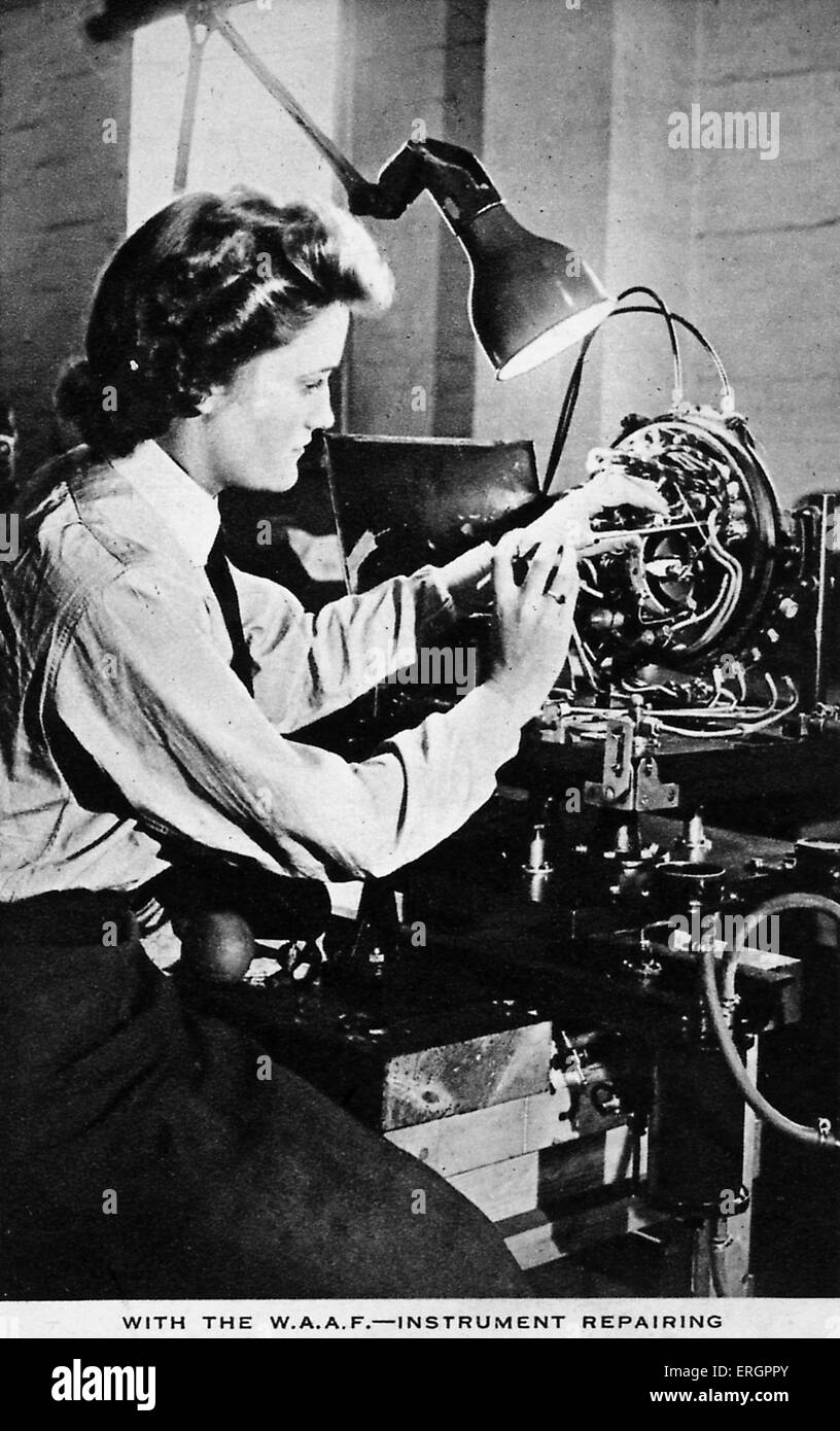 Women 's Auxiliary Air Force (WAAF) - Electrical repairs. A woman repairs an electrical instrument with a screwdriver. - Stock Image