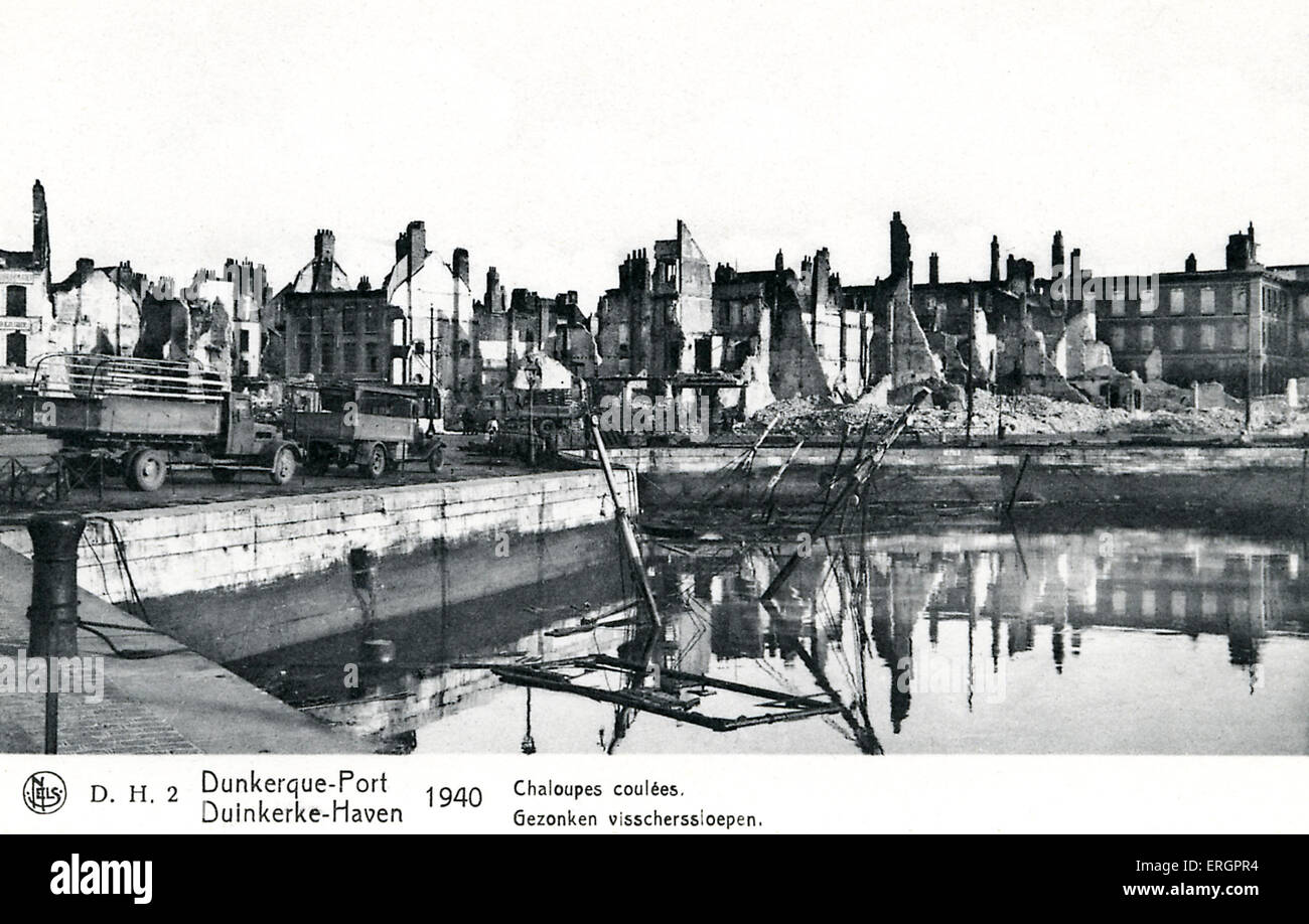 Dunkirk 1940 - view of ruined buildings and partially sunken ship. - Stock Image