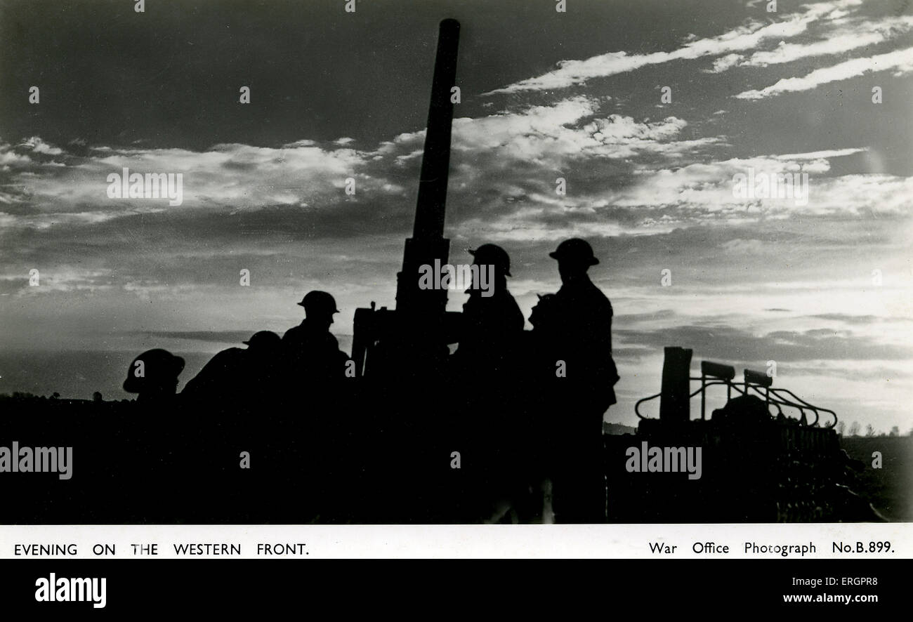 WW2 - Evening on the Western Front. Silhouettes of soldiers around an anti-aircraft gun. - Stock Image