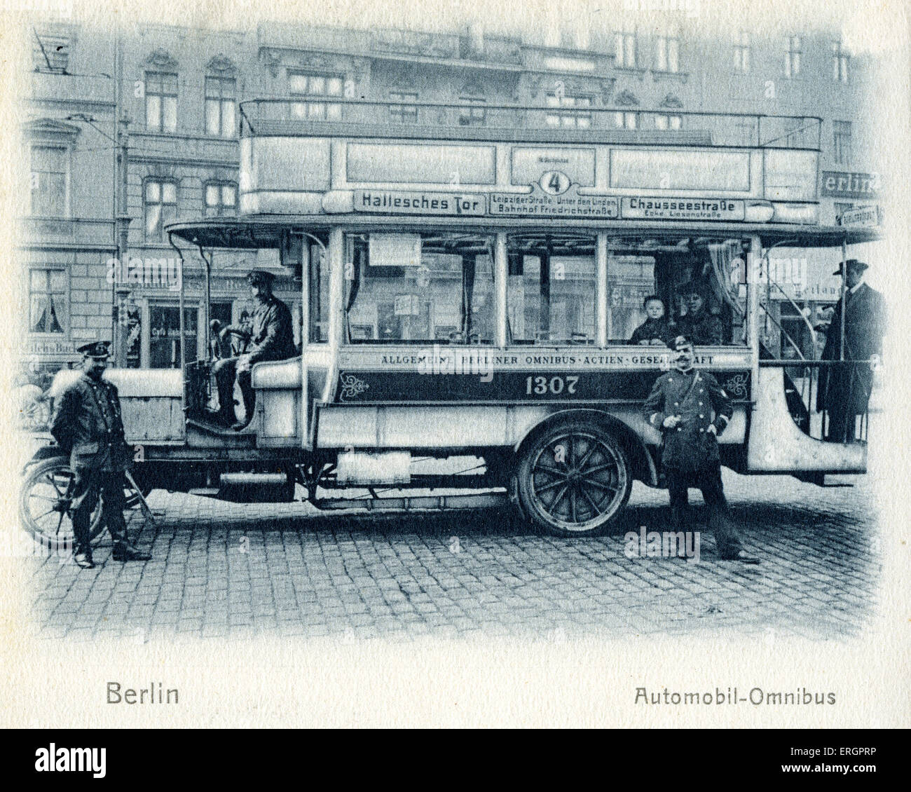 Berlin bus transport / omnibus. Open top double-decker bus with driver and conductor. Early 20th century. - Stock Image
