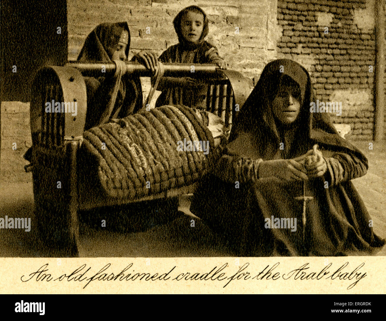 Iraq - caption reads:  An old fashioned cradle for the Arab baby. Photo taken in 1920s after creation of Iraq ( - Stock Image