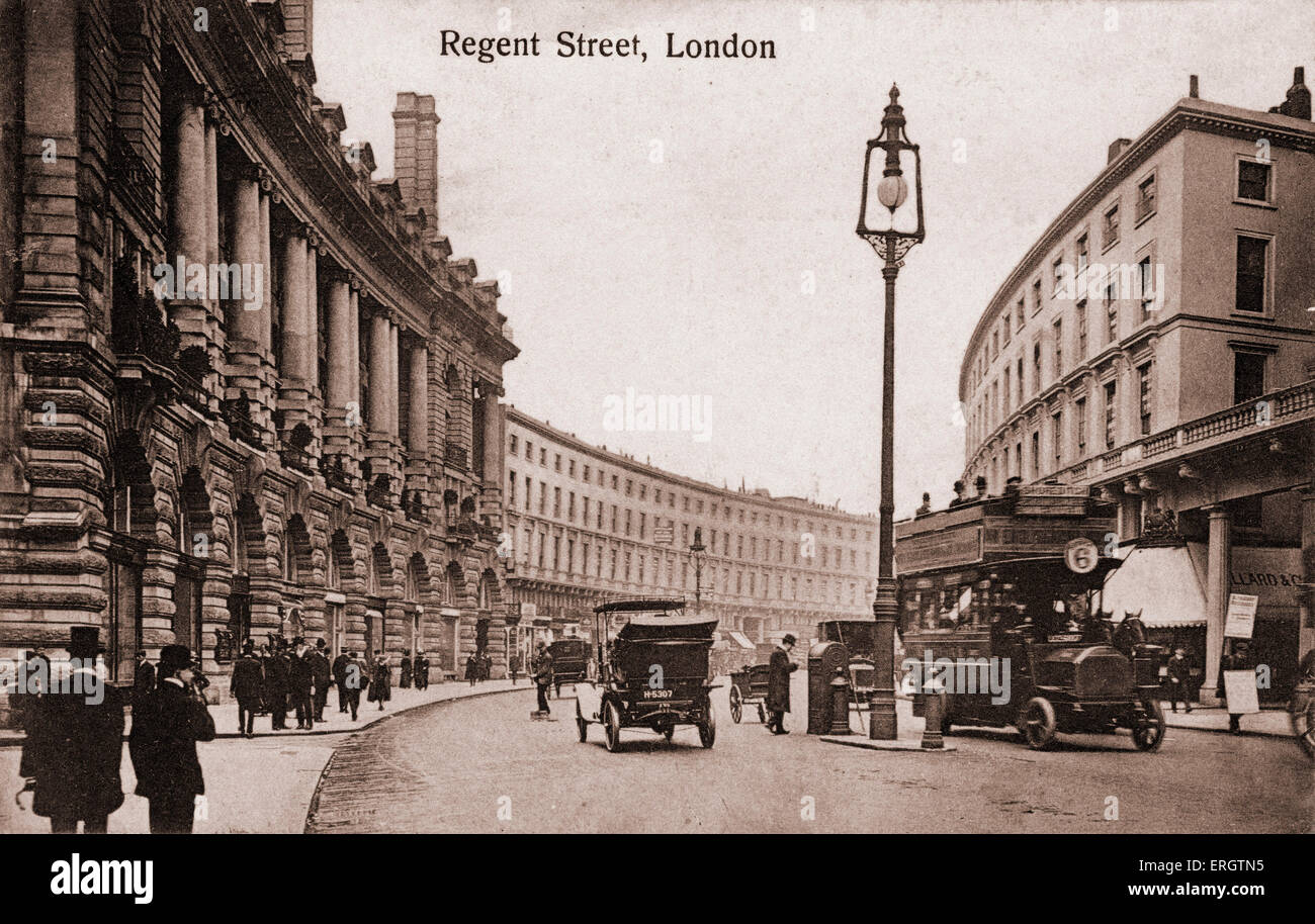 London -  Regent Street with early trams, cars. In early 1900s. Pedestrians . Top hats. - Stock Image