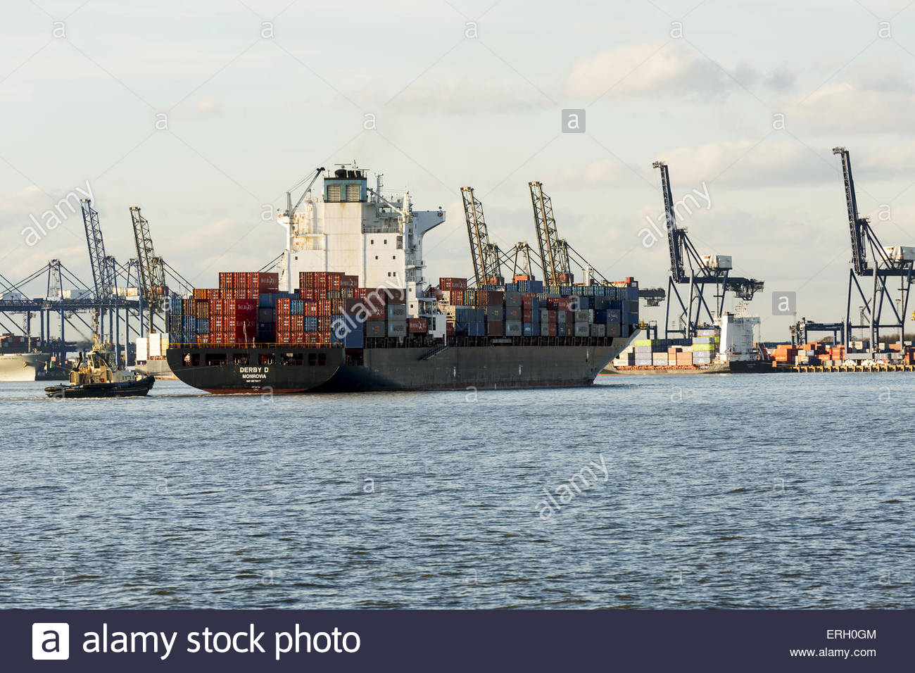 Ship approaches Felixstowe Container Port with tug escort - Stock Image