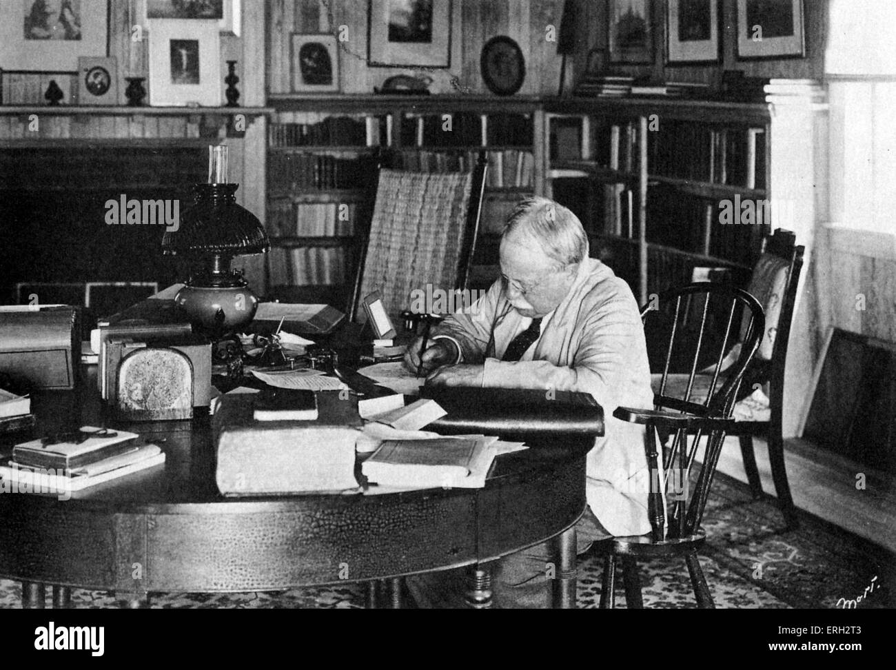 William Dean Howells writing at his desk at home, 225 Beacon Street, Martinsville, Ohio. American realist author, - Stock Image