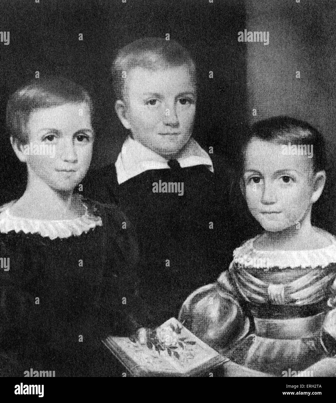 Emily Dickinson as a child with sisters, left to right: Emily, Austin, Lavinia. American poet. 10 December 1830 - Stock Image
