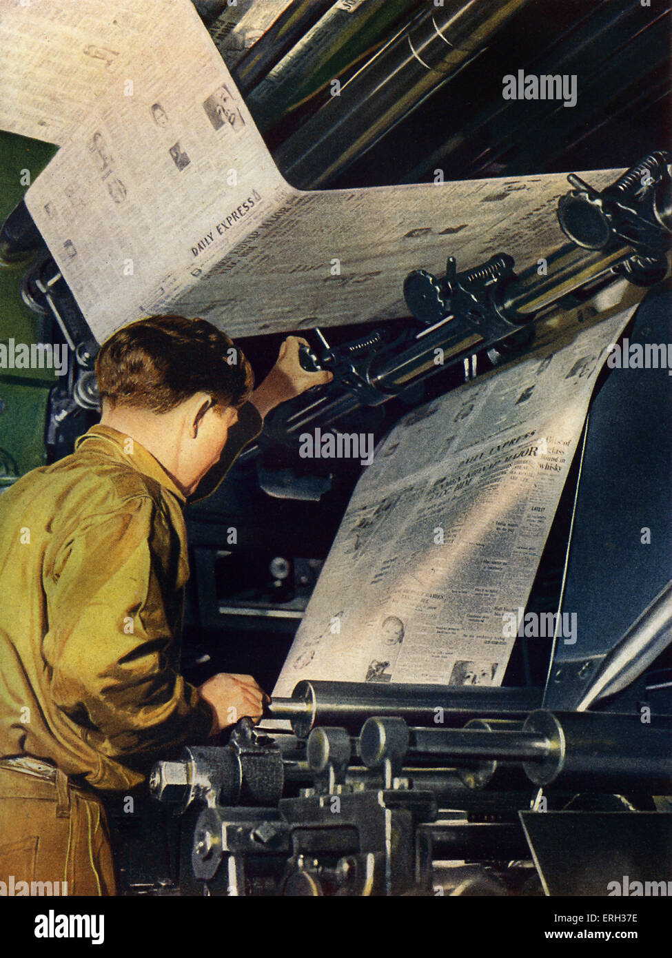 Newspaper Printing press, early 1950s. Operator inspecting newsprint, from The Wonder Book of How It's Done. Caption Stock Photo