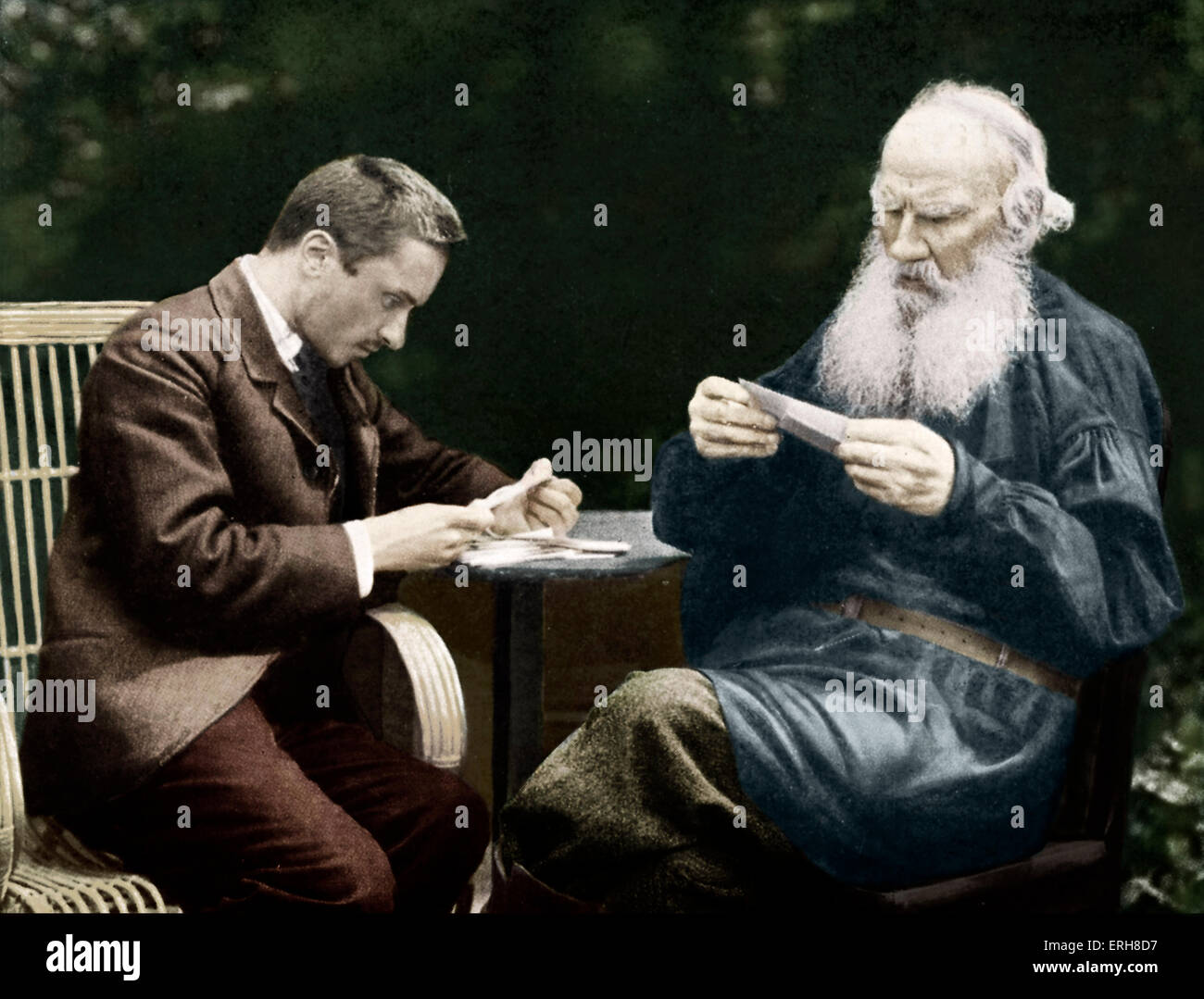 Leo Tolstoy and Valentin Bulgakov sorting post. Tolstoy (right), Russian novelist: 9 September 1828 - 20 November - Stock Image