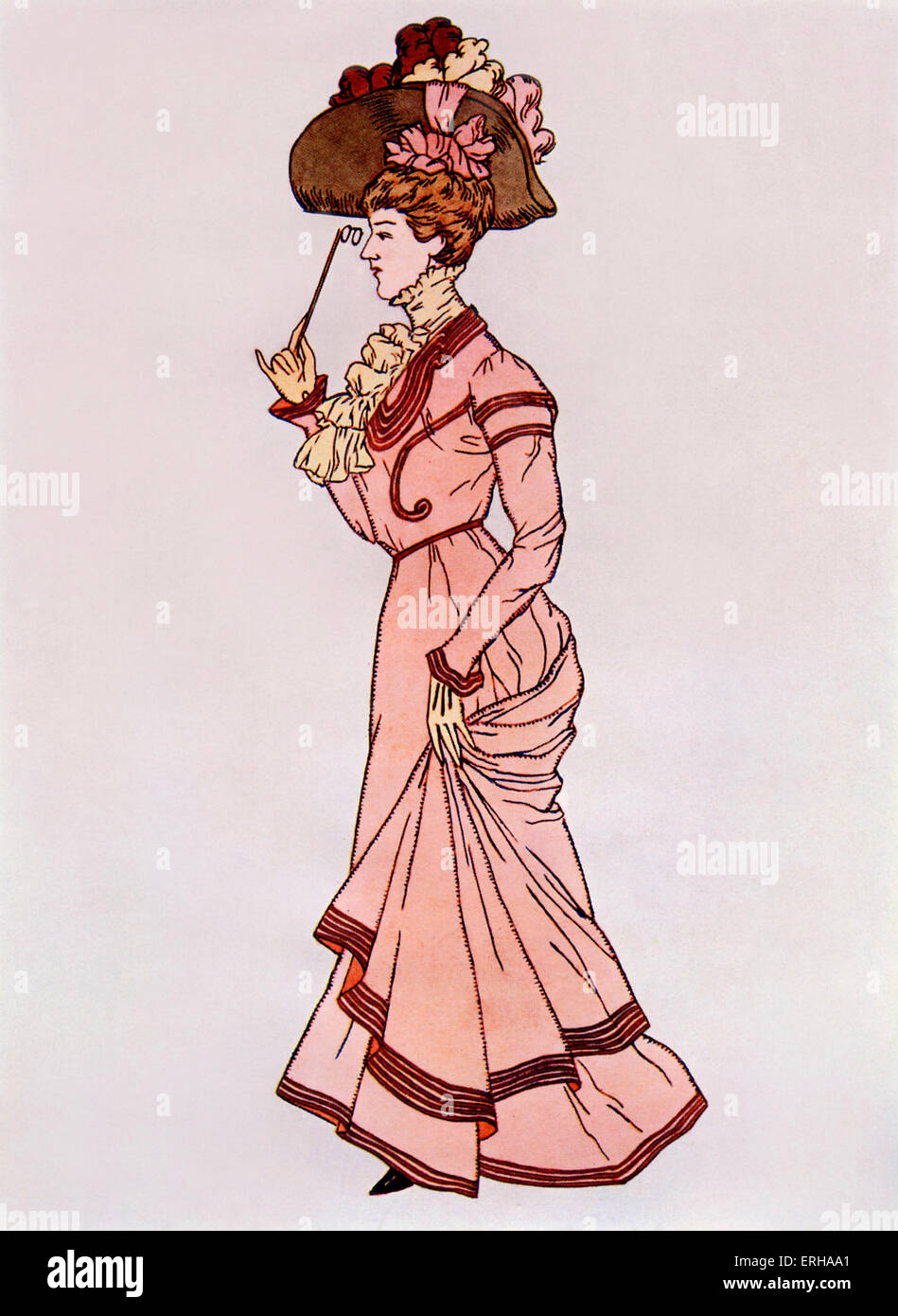 Lady wearing a 'walking costume', c.1900. Skirts in this era were made to trail upon the ground, and sometimes - Stock Image