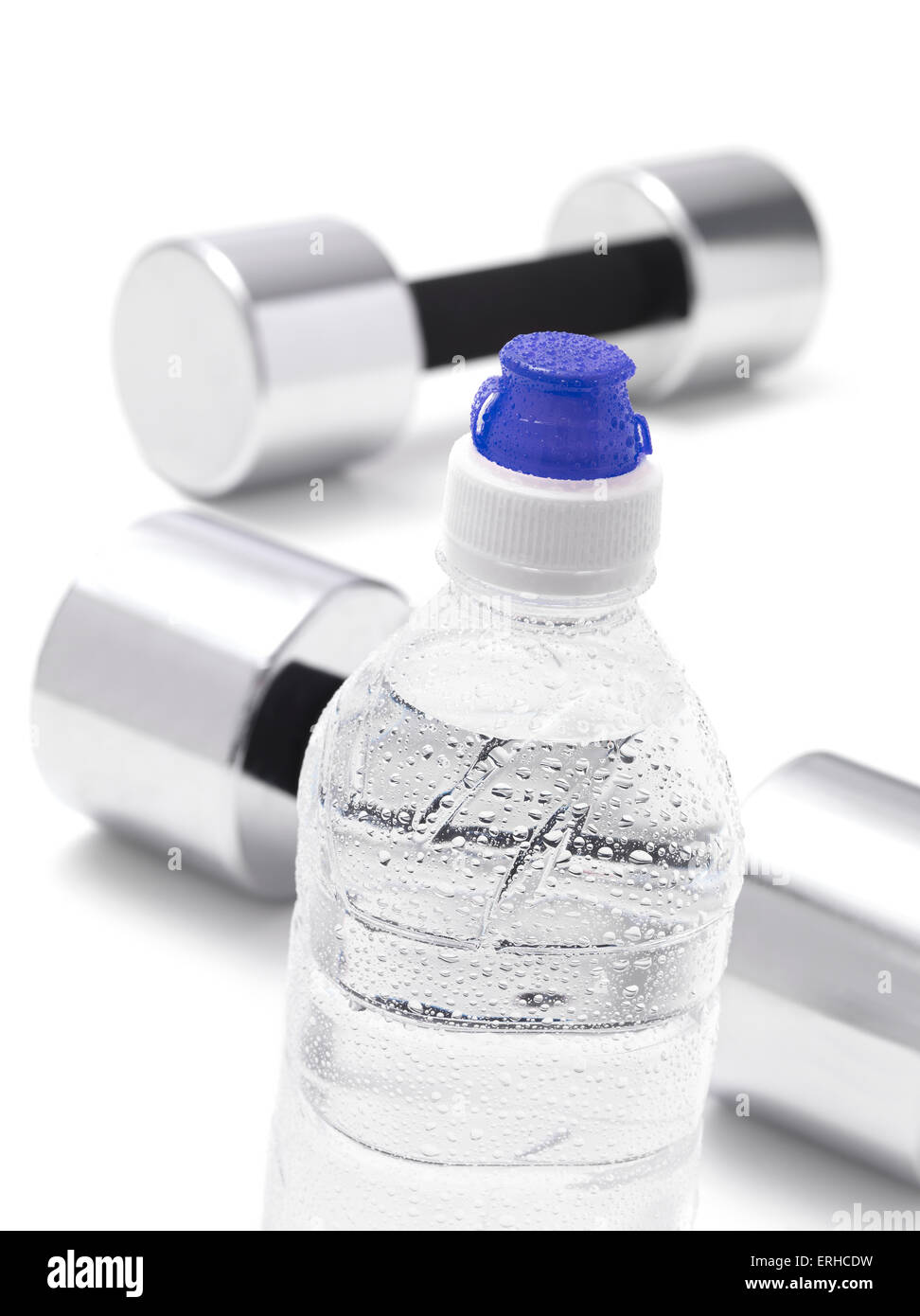 Gym Dumbbells with a water bottle - Stock Image