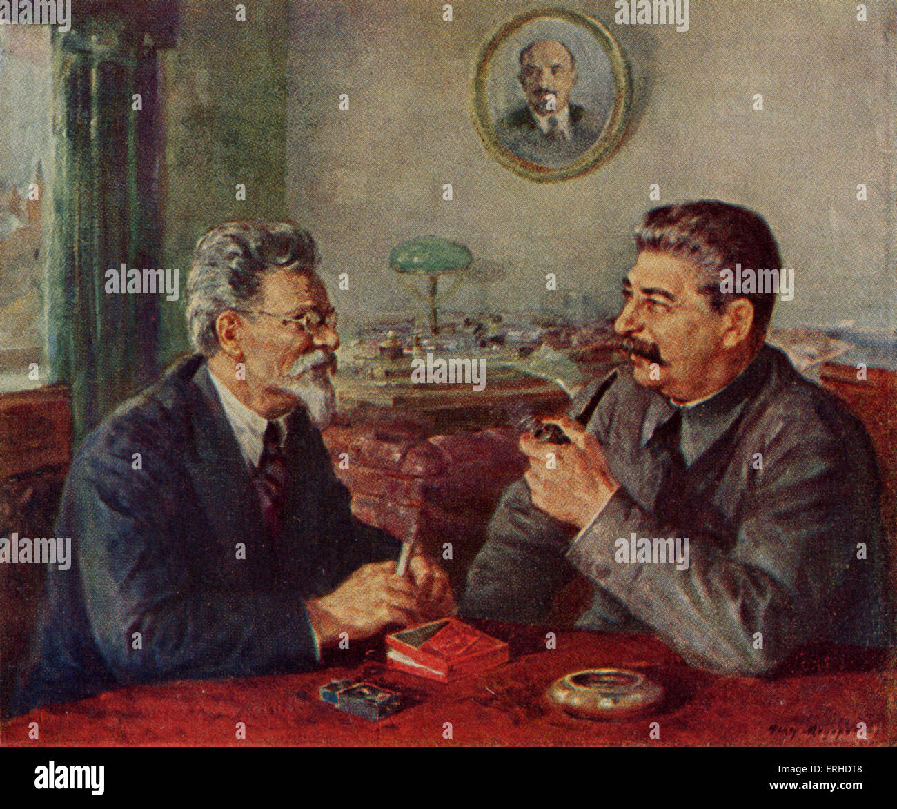 Joseph Stalin and Mikhail Kalinin in conversation. Portrait of Stalin can be seen in background. (Stalin: 1879-1953) - Stock Image