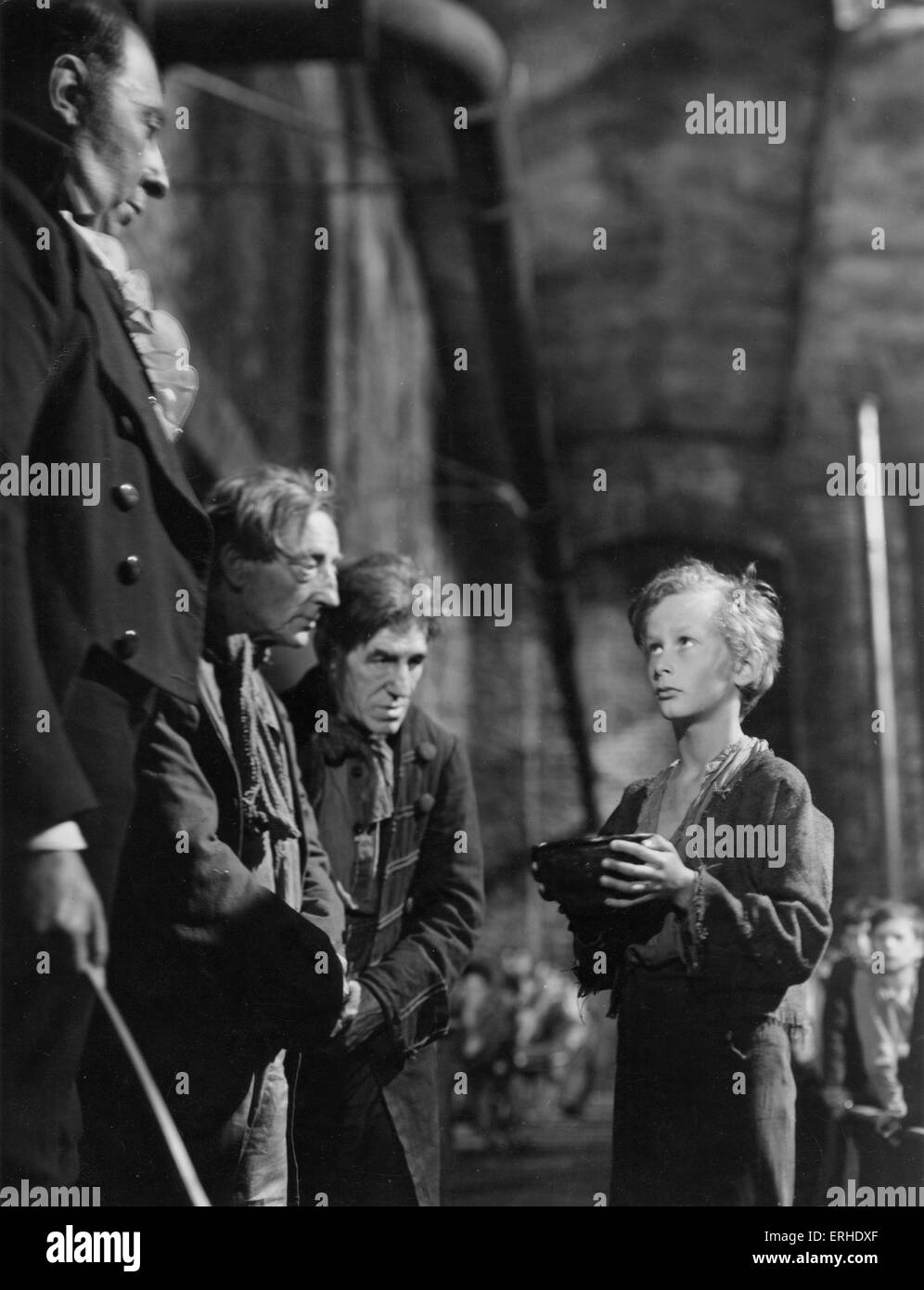 Oliver Twist. film still from 1948 Rank Film production of Charles Dickens  Oliver asks for more. British novelist, Stock Photo