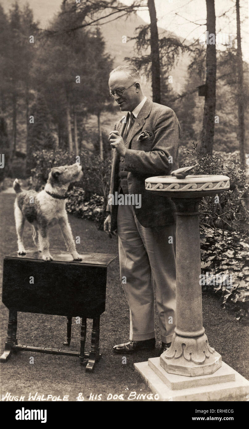 Sir Hugh Seymour Walpole - portrait of the popular English novelist with his dog, Bingo 1884-1941 Stock Photo