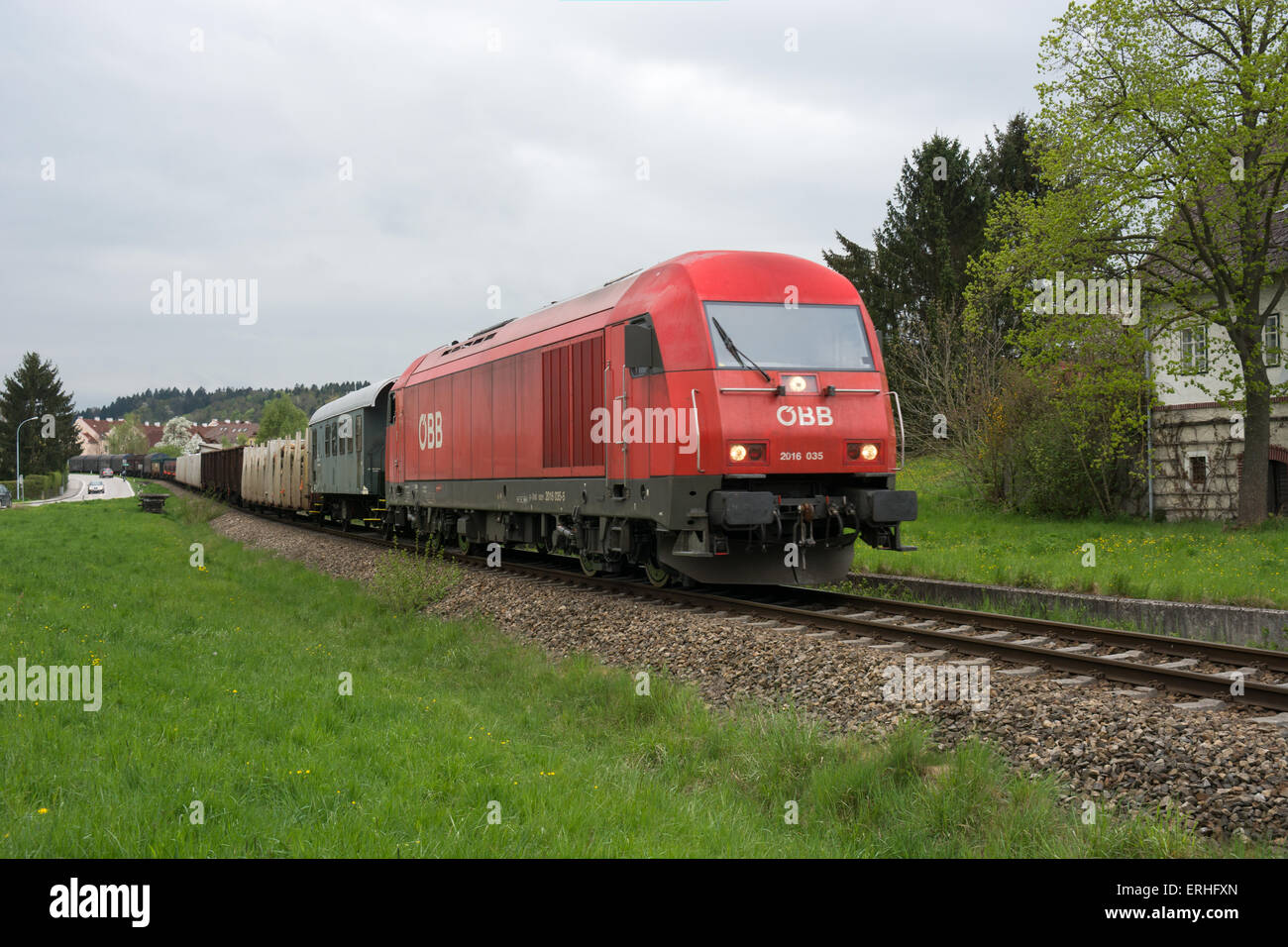 An Austrian Federal railways OBB mixed freight train heads along a single track line towards Wieselburg in lower - Stock Image