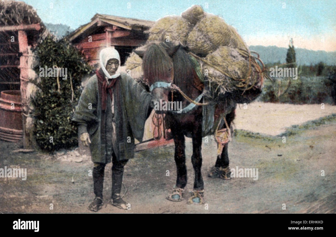 Japanese packhorse loaded up with bags of rice, accompanied by  Japanese man wearing wide sleeved jacket. agriculture, - Stock Image