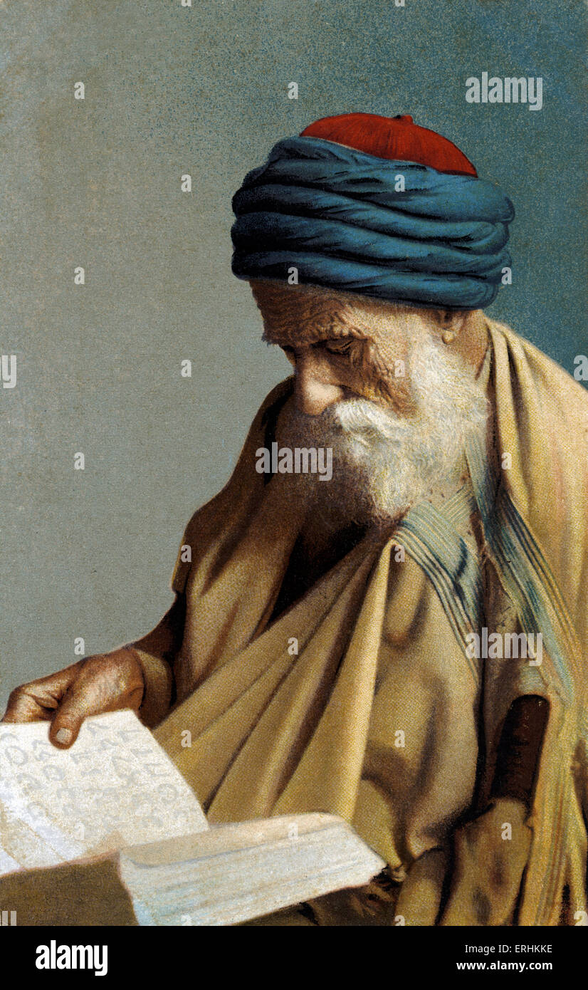 North African  Rabbi studying - reading from a Hebrew  book. Wearing Arab style headgear and clothing. - Stock Image