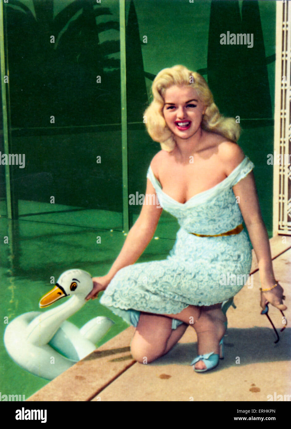 Diana Dors in decolleté dress and plastic duck in swimming pool. English actress - 23 October  1931 – 4 May - Stock Image