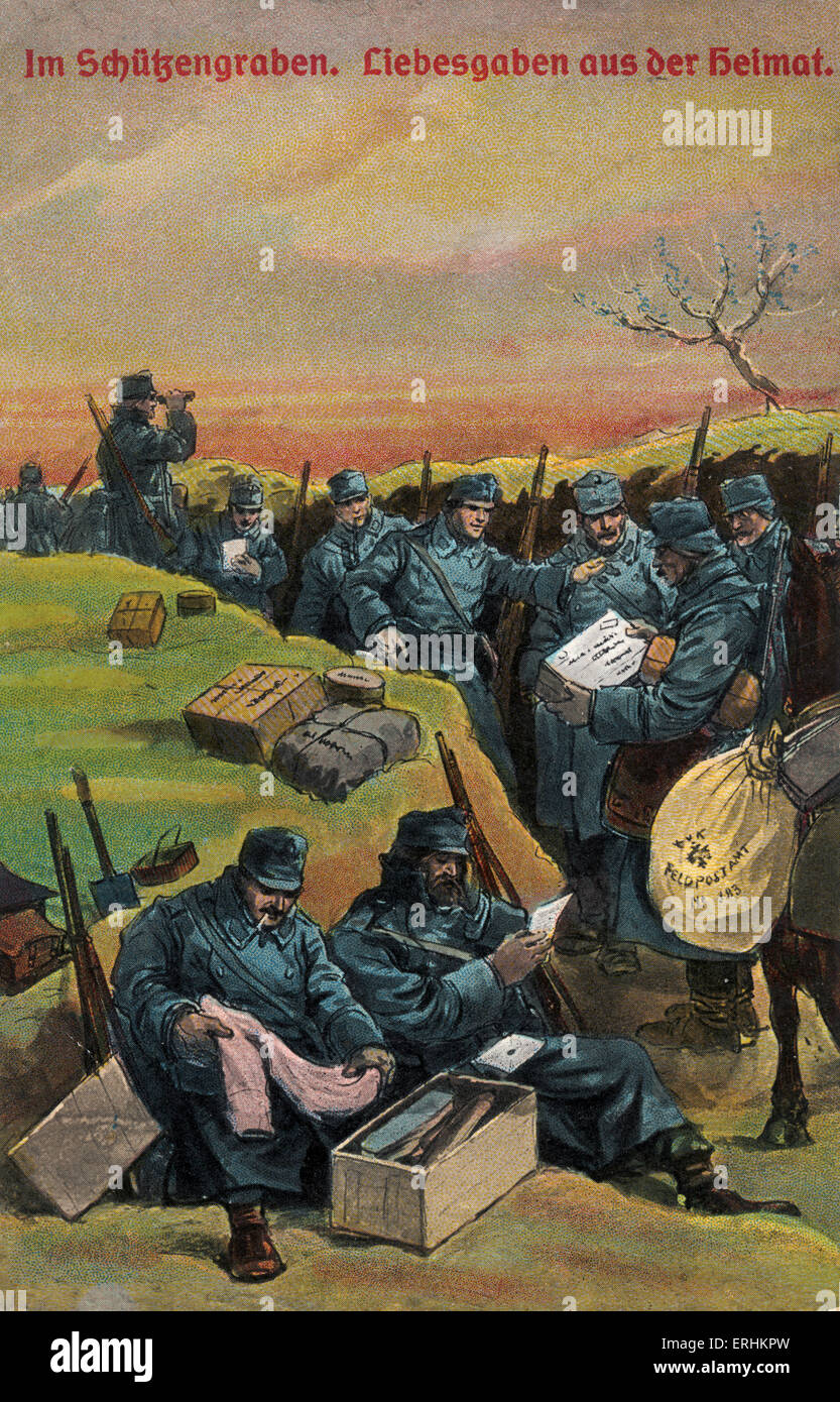 German soldiers in the trenches during World War I, receiving mail and parcels from their loved ones. Reads: 'Im - Stock Image