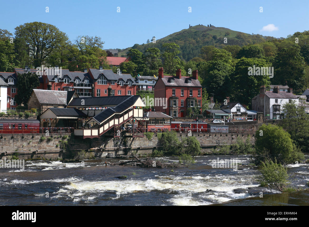 Looking across the river Dee to the station and the castle of Dinas Bran on the hilltop in Llangollen, north Wales Stock Photo
