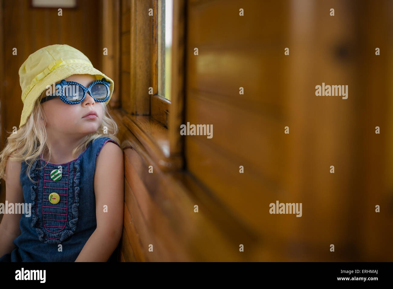Girl on a train looking out of the window - Stock Image