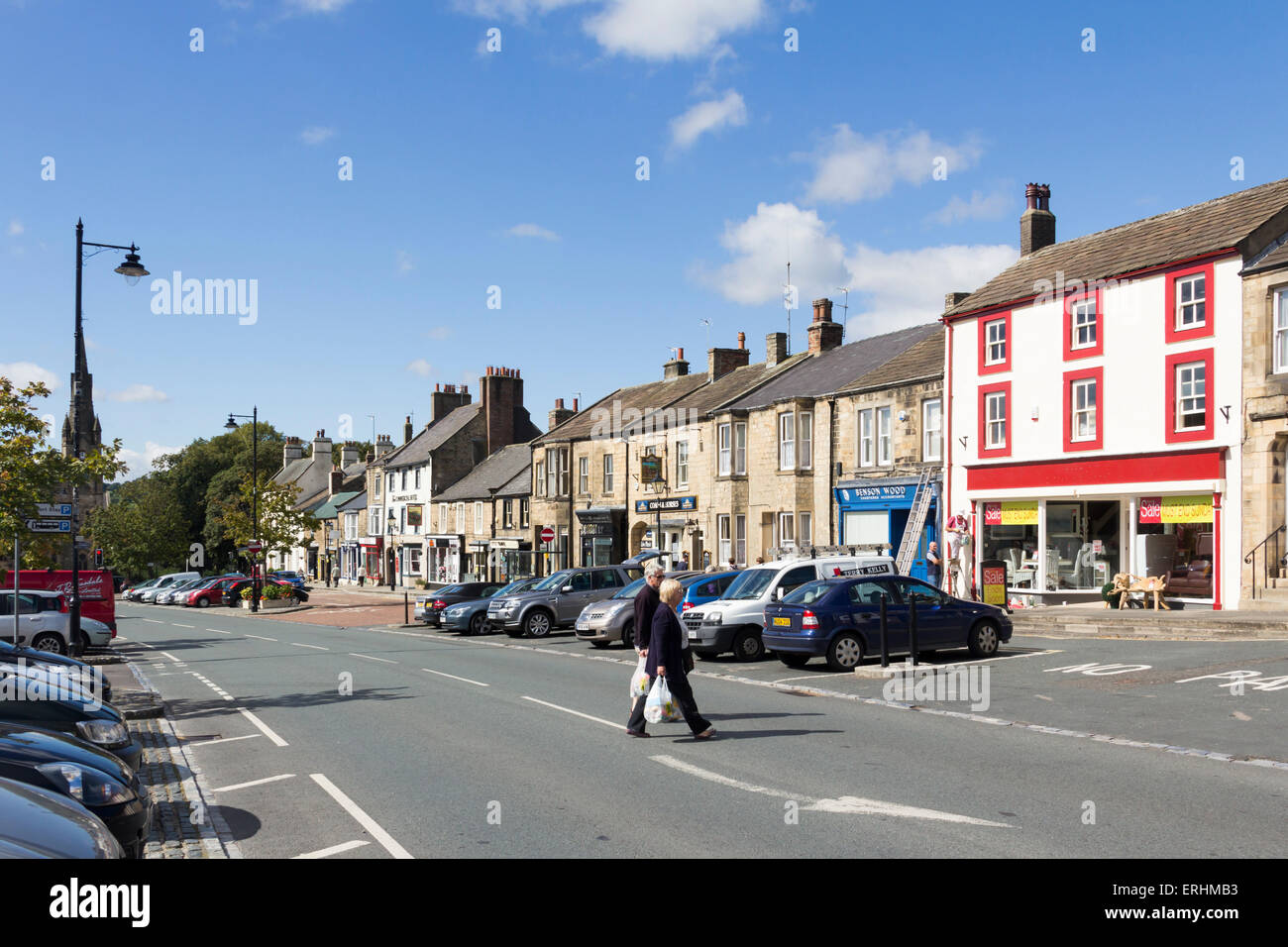 Shops and people on Galgate in Barnard Castle towncentre, County Durham. Viewing south-west. - Stock Image