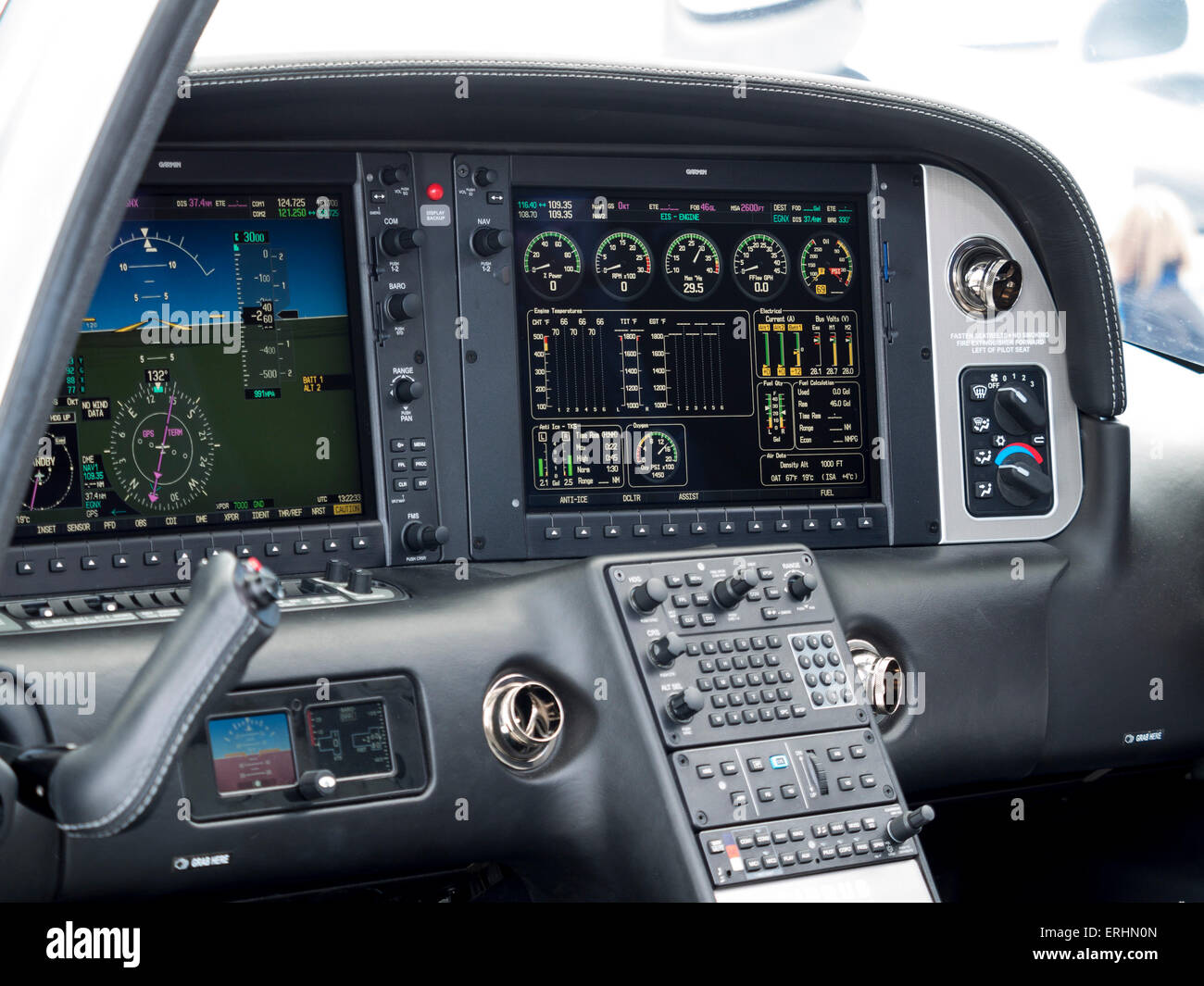 the high-tech 'all glass' cockpit of a Cirrus 22T/GTS two seater leisure aircraft,at Aerexpo 2015 aviation - Stock Image