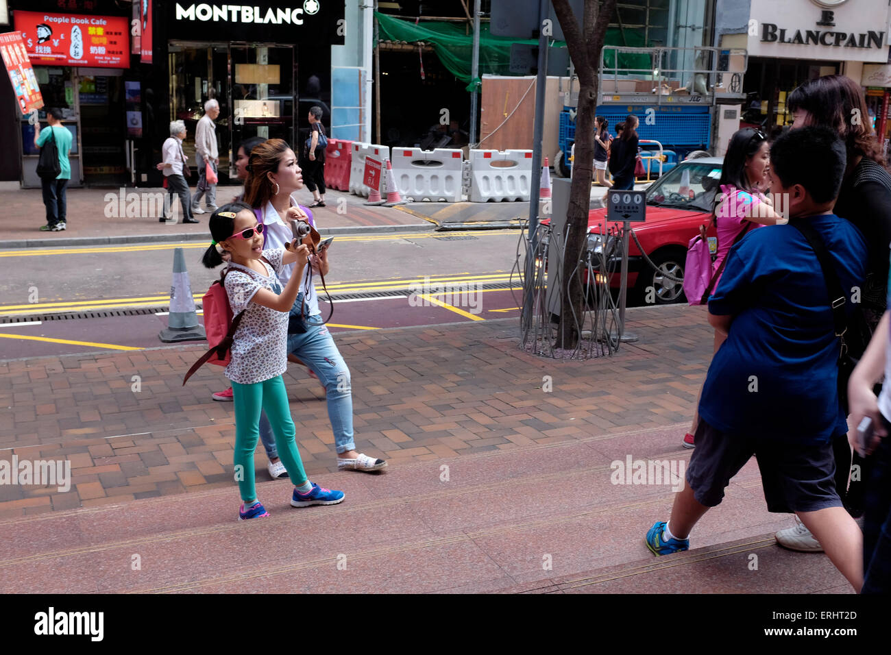 Tourists taking pictures in Causeway Bay, Hong Kong SAR, China - Stock Image