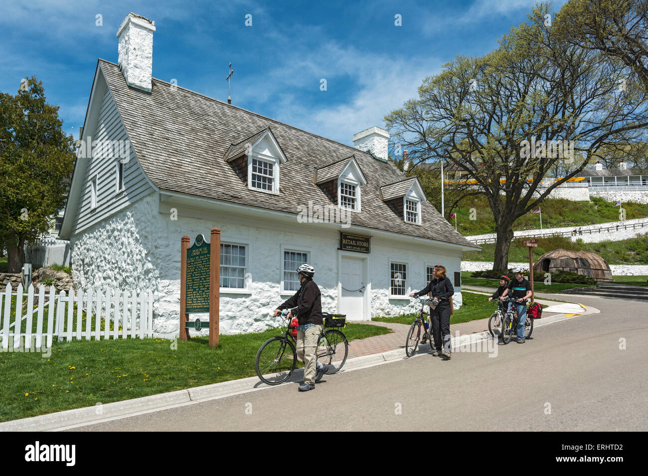Michigan, Mackinac Island, Market Street, American Fur Co. Store & Dr. Beaumont Museum, family bicyclists, bicycle - Stock Image