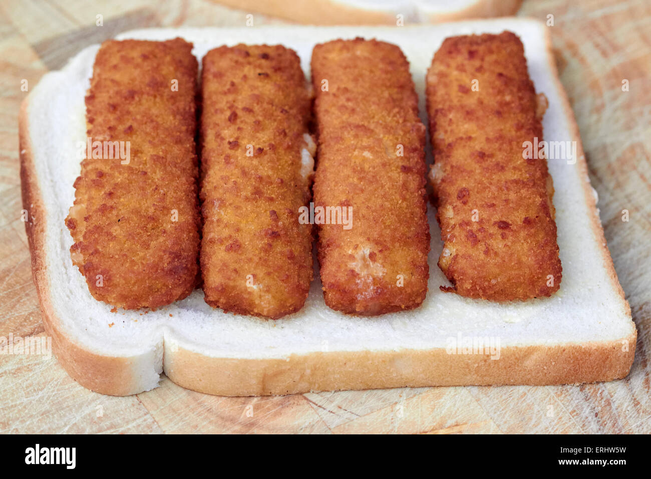 making a fish finger sandwich - Stock Image