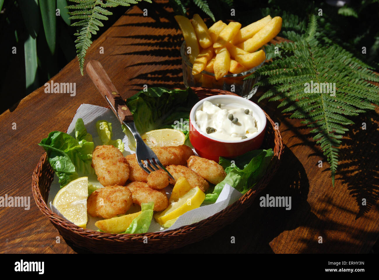 Scampi and chips in a basket with sauce Ta Ta - Stock Image