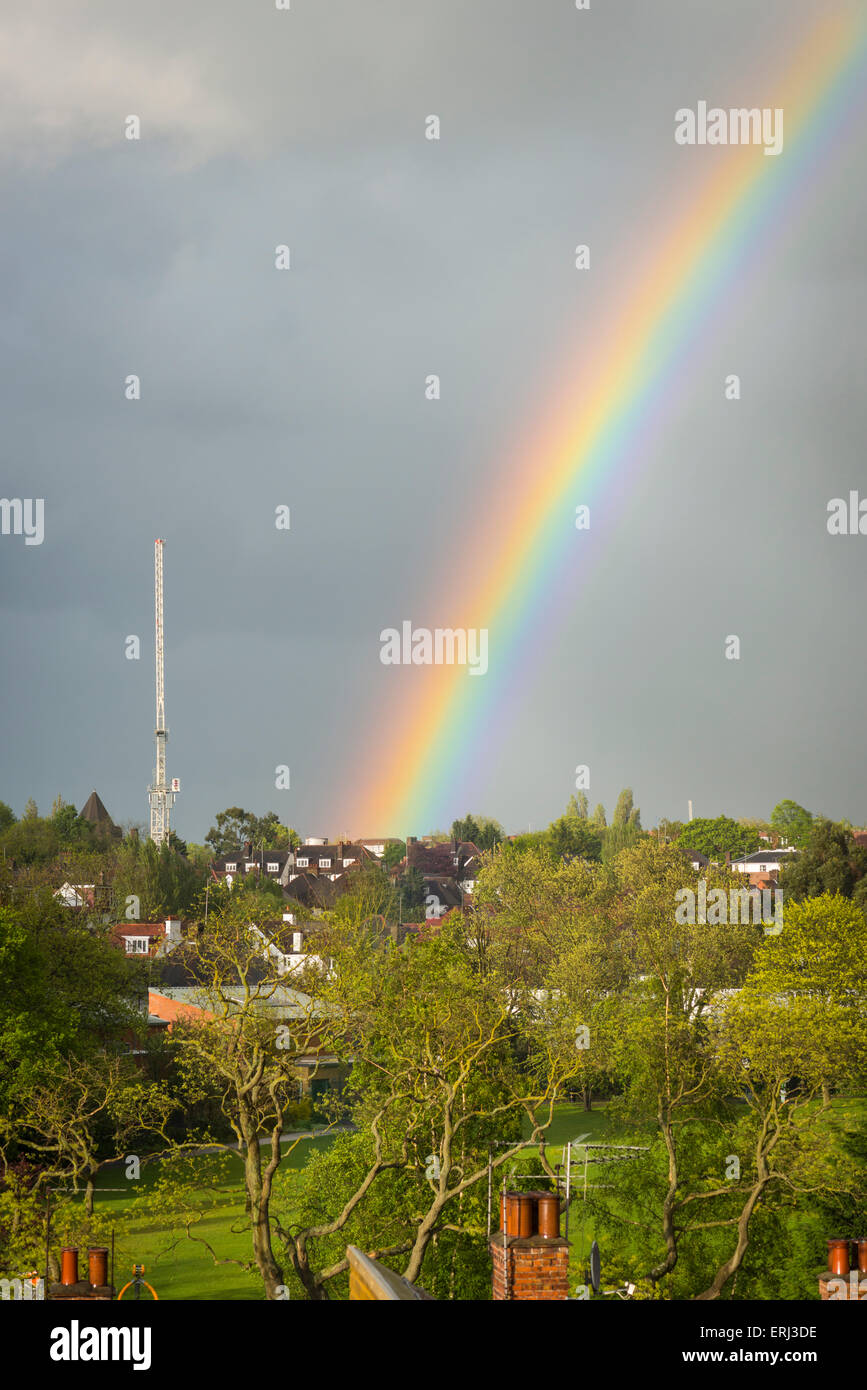 Rainbow rainbows over Golders Green North West London grey gray sky trees Childs Hill Park - Stock Image