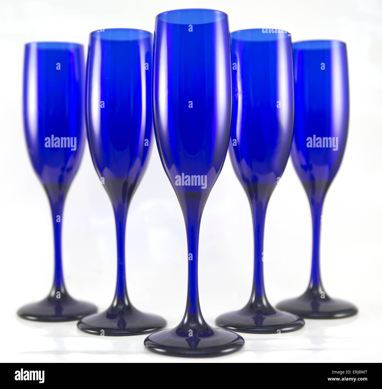 Set of 5 Blue Champagne Flutes on White - Stock Image