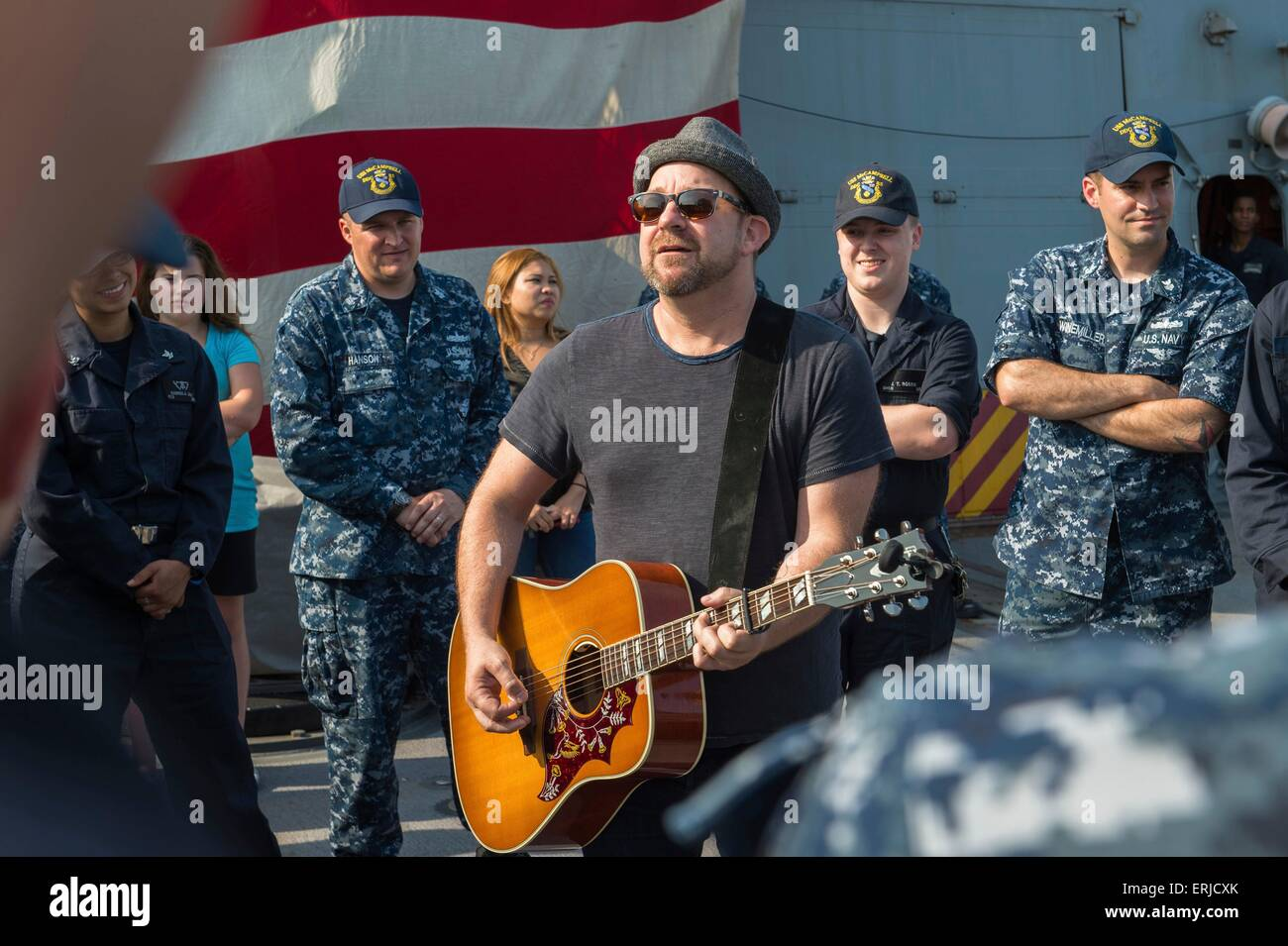 Two-time Grammy award-winner and founding member of the band Sugarland, singer Kristian Bush, performs for US sailors - Stock Image
