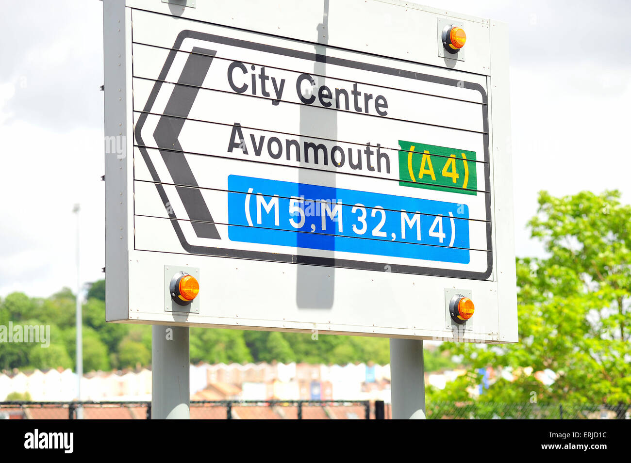 A road sign in Bristol directing traffic towards the city centre and Avonmouth. - Stock Image