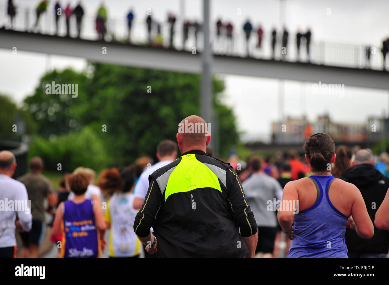 Runners participate in the Bristol 10k race. - Stock Image