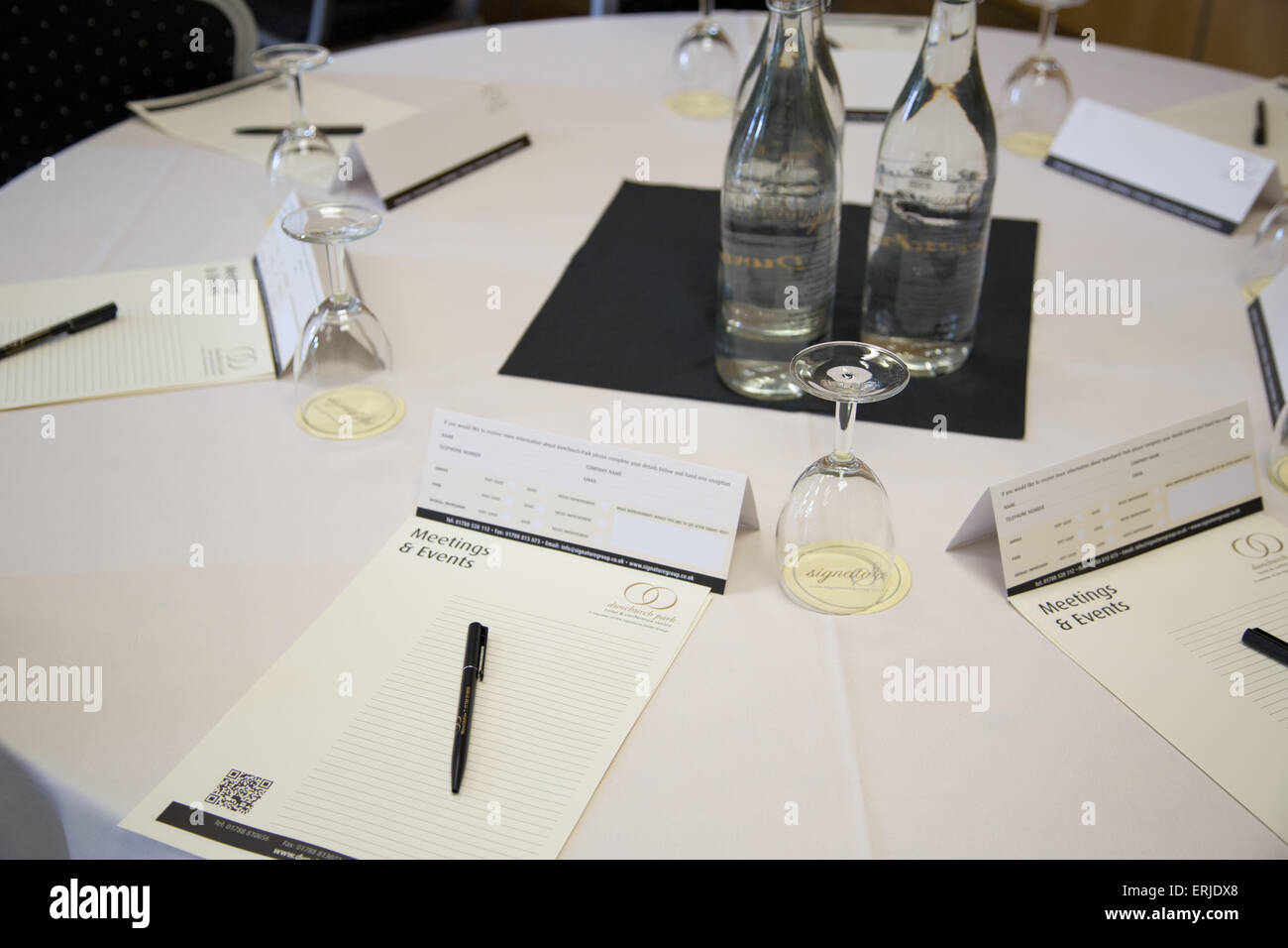 A Table In A Conference Room Set Up Ready For A Business - Conference room table set
