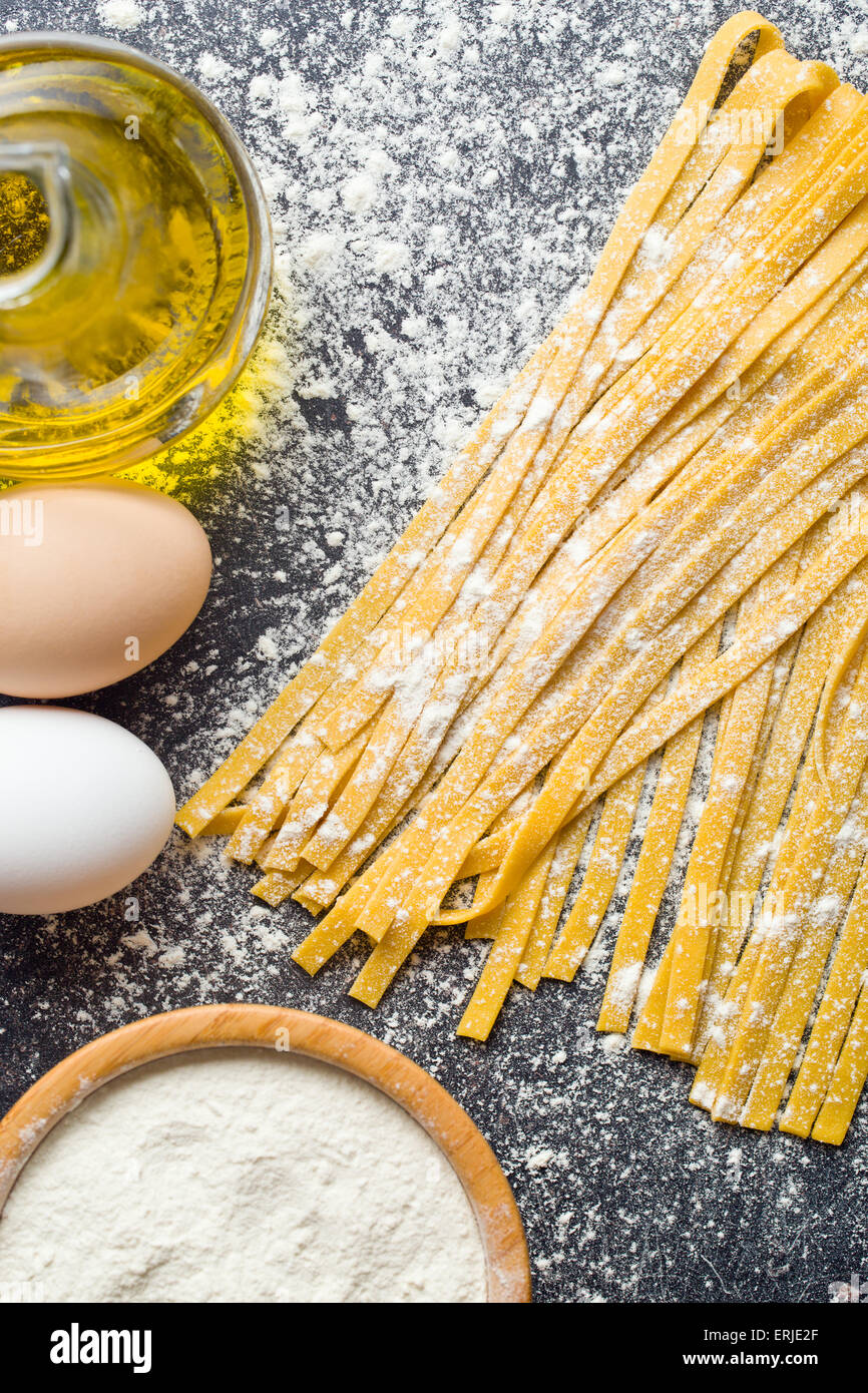 fresh homemade pasta on kitchen table - Stock Image