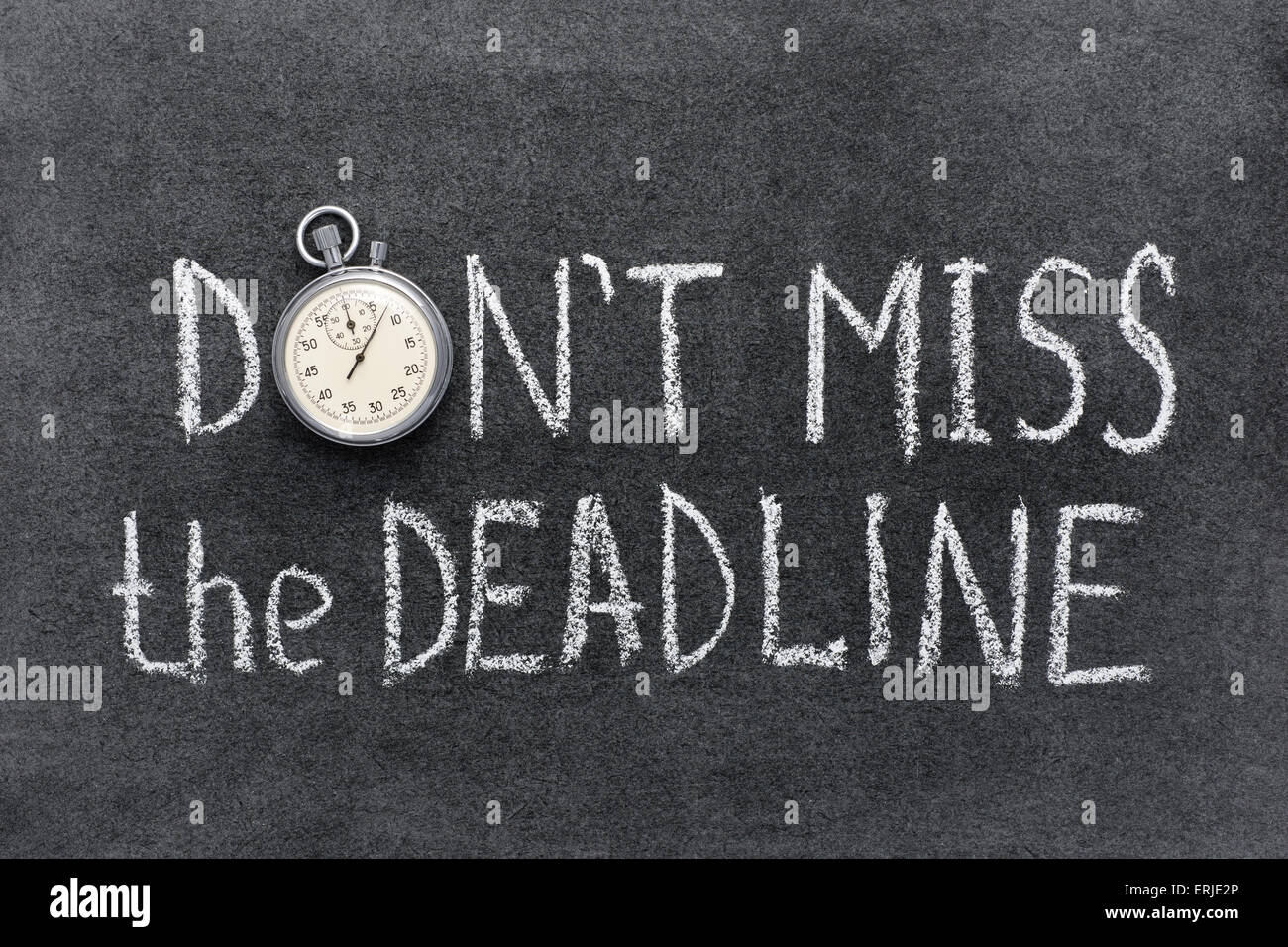 don't miss the deadline concept handwritten on chalkboard with vintage precise stopwatch used instead of O Stock Photo