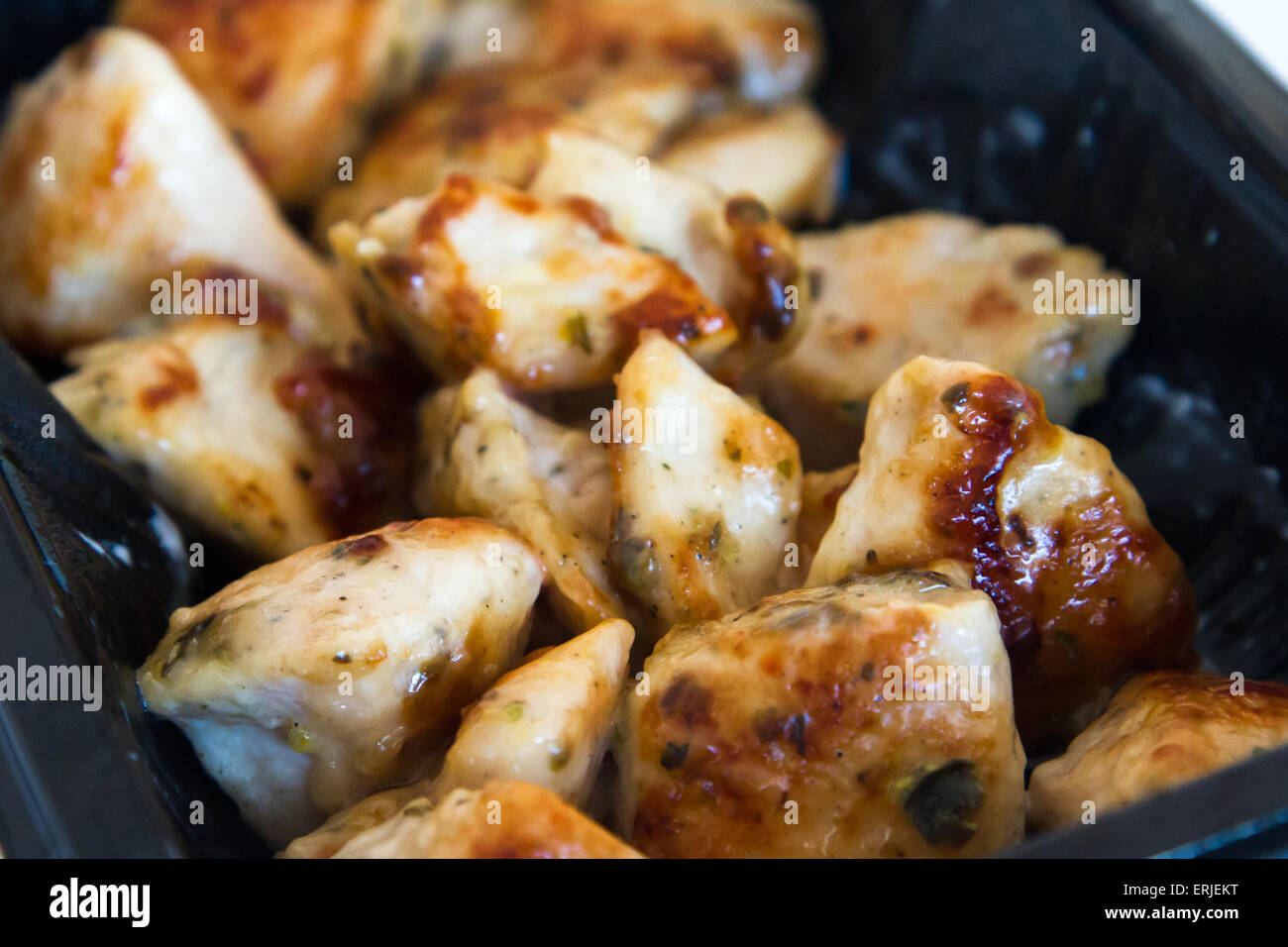 Fried chicken wings with sauce. - Stock Image