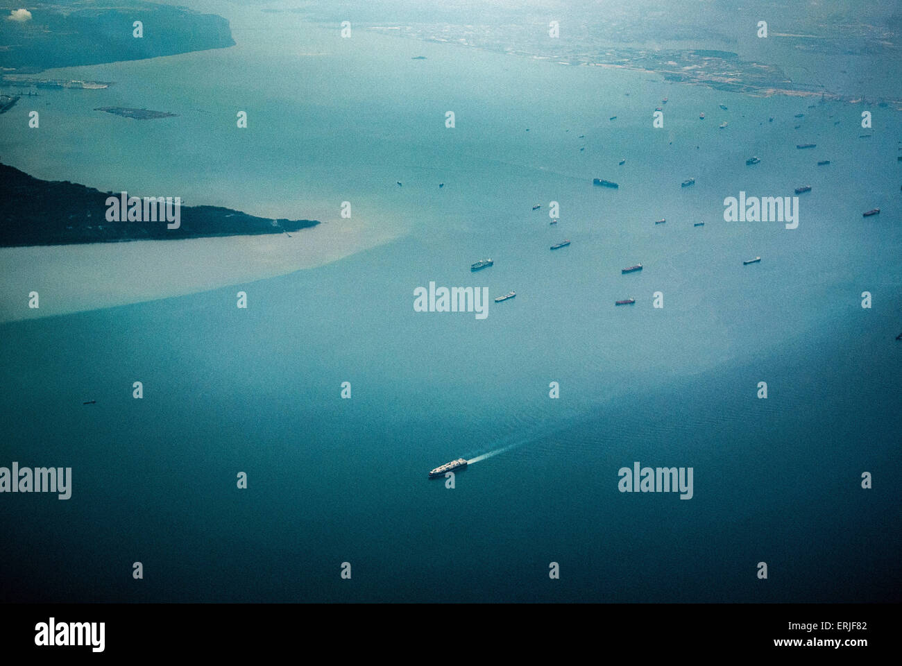 Aerial photo of ships and Southern tip of Malaysia - Stock Image