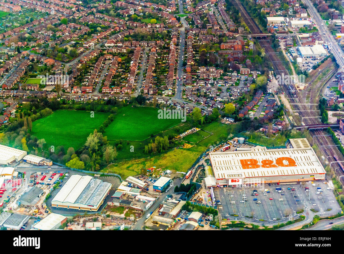 Aerial photo of suburban homes in UK and B&Q DIY store - Stock Image