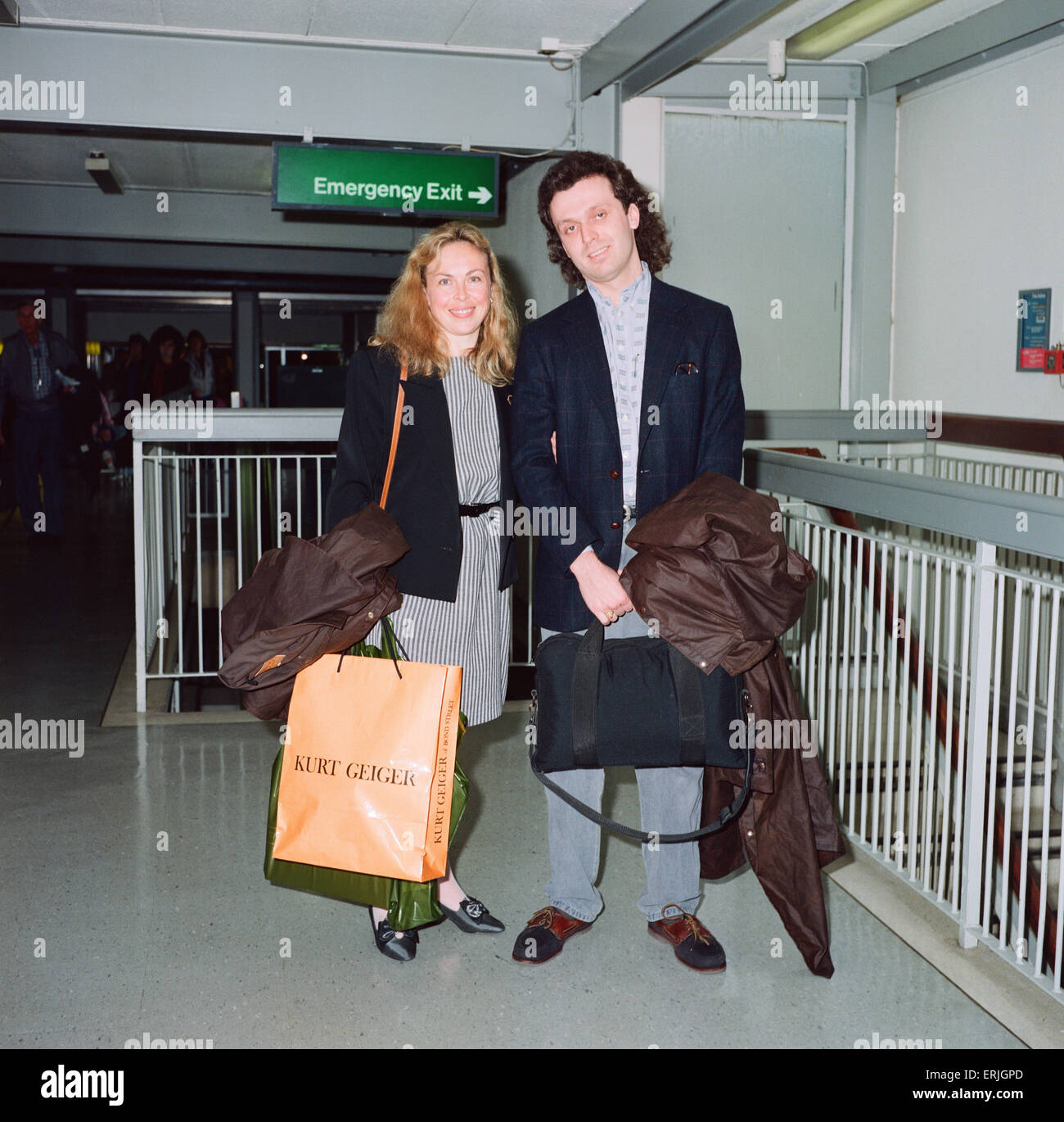 Jayne Torvill and husband Phil Christensen arrive at London Airport. 17th May 1991 - Stock Image