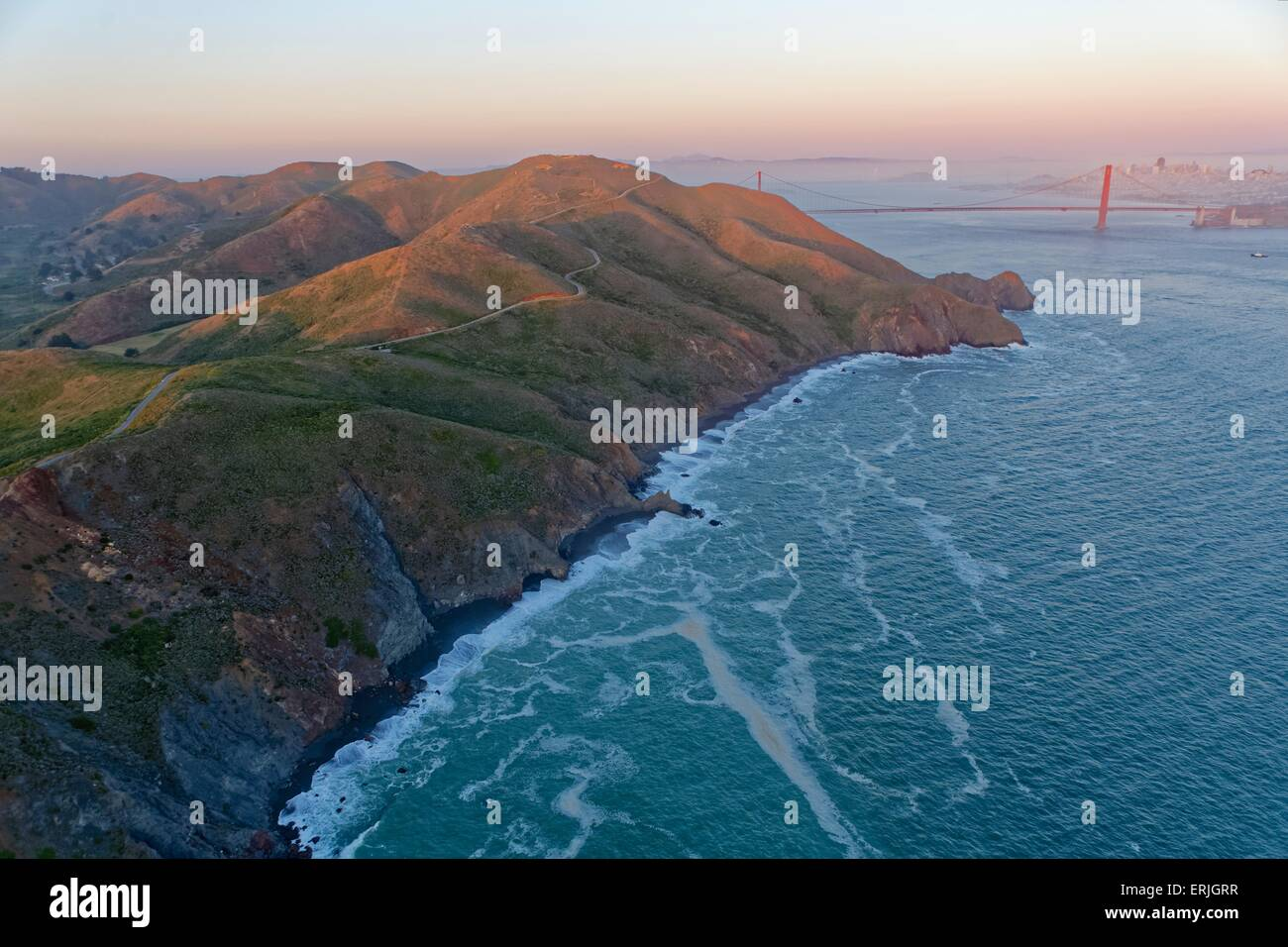 Aerial view over  the Marin Headlands and the Golden Gate Bridge in San Francisco at sunset - Stock Image