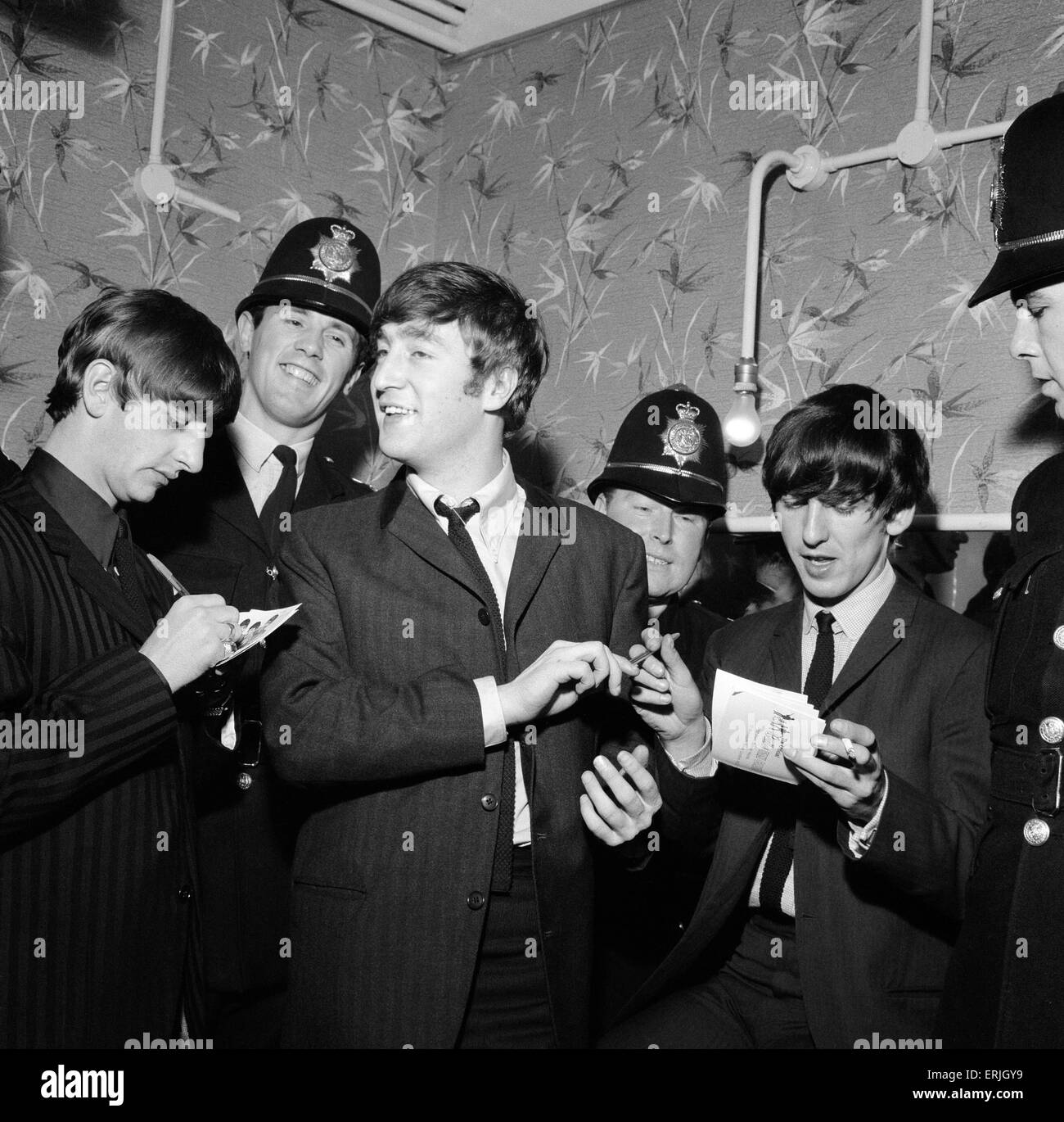 Pop Group The Beatles November 1963 The Beatles sign autographs for birmingham policemen, who helped smuggle them - Stock Image